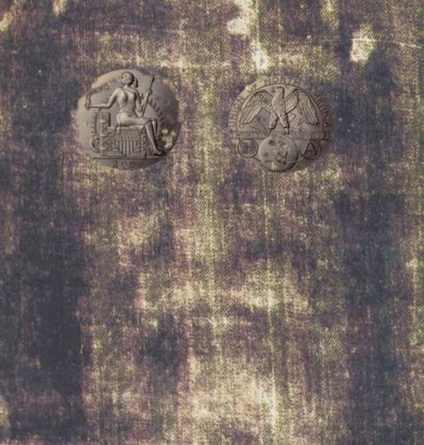 sindone particolare con monete